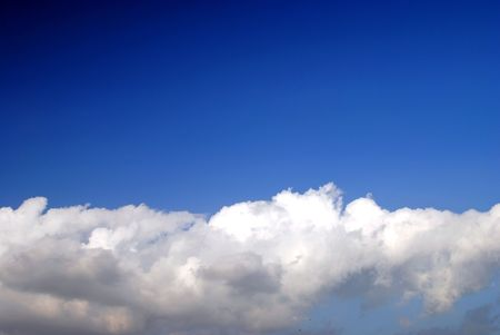 storm clouds clearing beneath a deep blue sky, background for your text