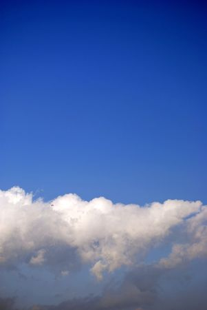 storm clouds clearing beneath a deep blue sky; background for yur text Stock Photo