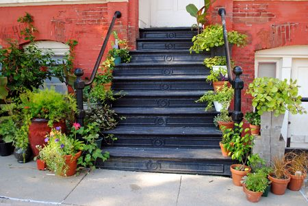 Iron stairway entry to a florist shop in an old building vintage 1800s