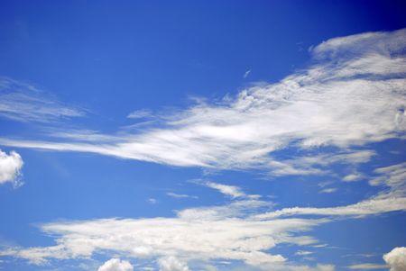 cirrus: Bright blue sky with wispy cirrus clouds.