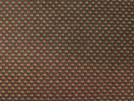 Carpet pattern in deep red, navy blue, and creamy gold makes good background for your copy.