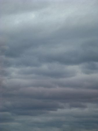 Low grey stratus clouds llinger after a storm.  Good background for your copy.