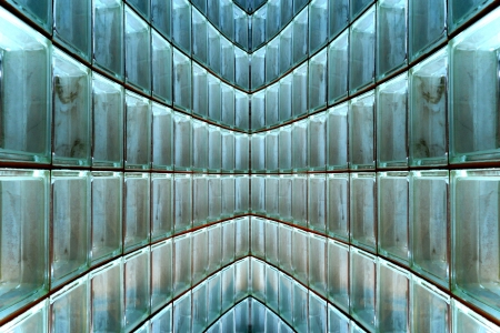 Curved glass block wall, closeup, makes graceful abstract pattern of arcs and lines.  You can rotate clockwise for original orientation.