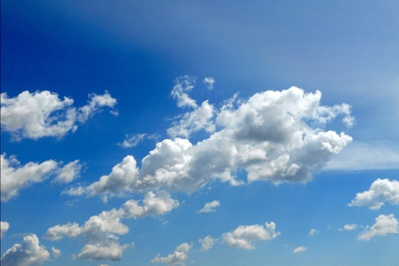 Fragmented summer cumulus clouds in a deep blue sky