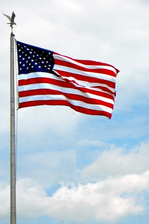 u s  flag: Stars and stripes; the U. S. flag flies proudly in the breeze.