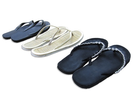 liesure: Sandals in a row, isolated on white background
