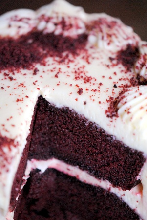 Red velvet chocolate cake with cream cheese frosting.  Decadent.  Delicious. Stock Photo