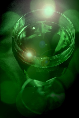 A mysterious glass goblet filled with green liquid Imagens