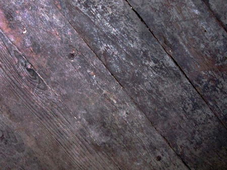 Distressed wooden board surface at diagonal angle makes grunge background. photo