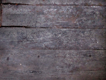 Distressed wooden board surface lengthwise makes good  grunge background. Stock Photo - 10414921