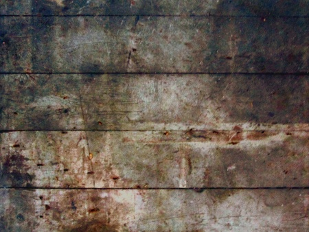 Distressed wooden board surface lengthwise makes good grunge background. Stock Photo