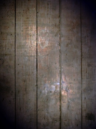 Distressed wooden board surface lengthwise with two spotlight highlights makes good grunge background. Stock Photo