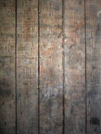 苦しめられた木の板の表面で強調表示スポット ライトが良いグランジ背景。 写真素材