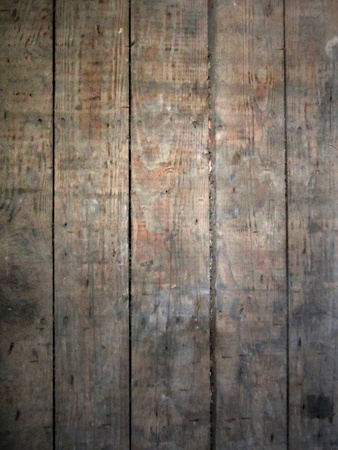 Distressed wooden board surface with spotlight highlight makes good grunge background. Stock Photo