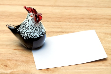 Decorative art glass chicken with note paper copy space. Stock Photo