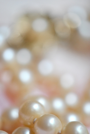 Pearl necklace on lace fabric. Shallow DOF