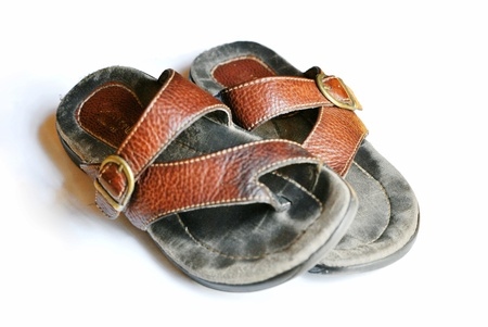 A well-worn pair of leather thong sandals.