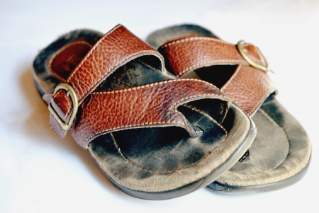 worn: A well-worn pair of thong sandals.  Shallow DOF. Stock Photo