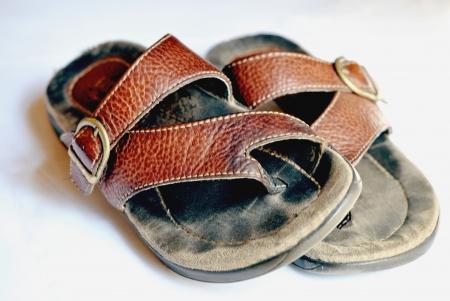 worn: A well-worn pair of thong sandals.  Shallow DOF. Stock Photo