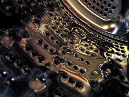 Inside a stainless steel drum of a laundry machine. photo