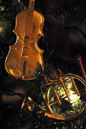 violins: Golden miniature musical instrument Christmas ornaments. Stock Photo