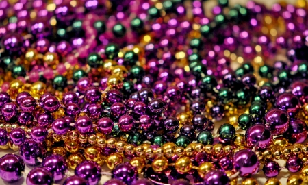 Background of Mardi Gras beads with shallow DOF photo