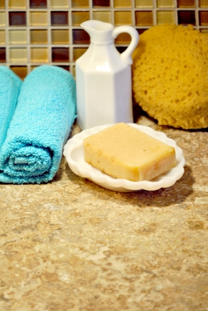self indulgence: Bath and spa supplies;   towels, soap, sponge, and pitcher of bath oil