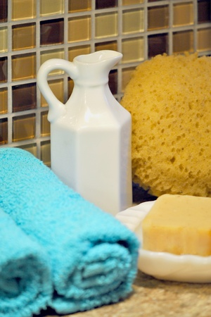 liesure: Bath and spa supplies;  towels, soap, sponge, and pitcher of bath oil  Stock Photo
