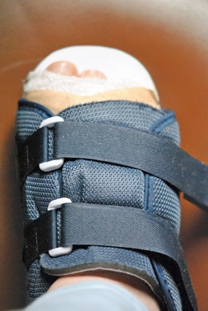 Injured foot with bandages and orthopedic shoe Stock Photo - 12576565
