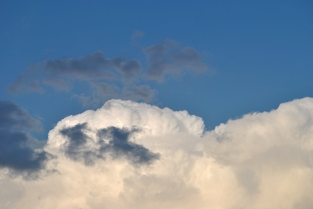 Bright blue sky with cumulus clouds of a weather front advancing  Stock fotó