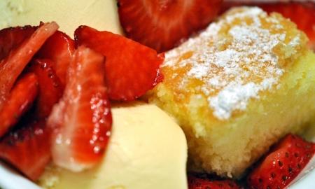 Strawberry shortcake; ice cream, cake, and fresh strawberries. Stock Photo