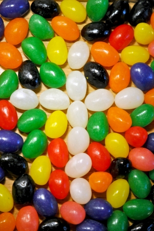White jelly beans form a cross among the colorful assortment of candy  photo