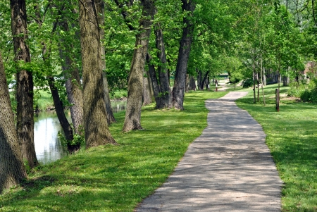 replaces: A shady paved walk replaces the towpath beside the I M Canal at Lockport, Illinois, USA   This canal was the first navigable connection between the Great Lakes and the Mississippi basin