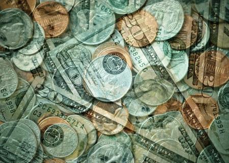 US twenty dollar bills and mixed denomination coins