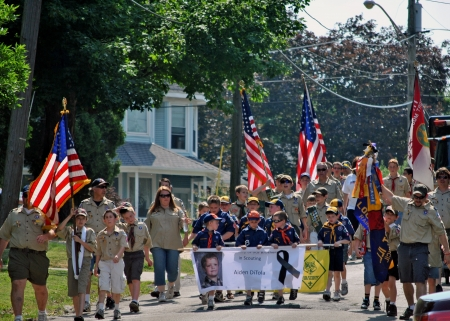 All across America, towns of all sizes honor those who died in military service to their country   Here Cub scouts and Boy Scouts march in the Memorial Day parade, May 28, 2012, Lockport, IL  USA