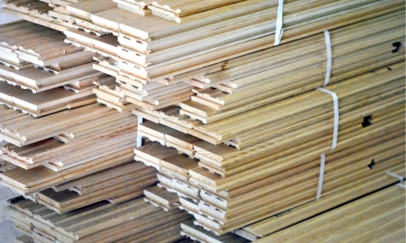 tongue and groove: Bundles of flooring material stacked ready for installation