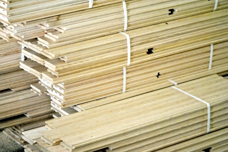 Bundles of flooring material stacked ready for installation