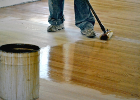Applying the finish to the new floor Stock Photo - 14212907