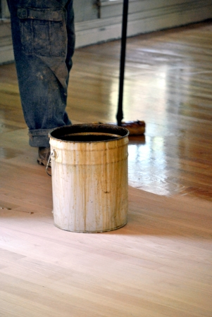 Applying the finish to the new floor Stock Photo - 14212911