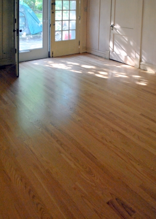 wood flooring: While this new floor was being installed and finished, the family camped out in the backyard