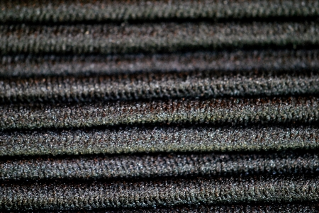 Extreme closeup of elasticized bands for styling long hair; makes interesting abstract striped background