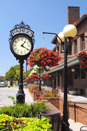 Fargo, North Dakota historic railroad depot, restored and converted for use as a senior citizens center, features the vintage clock and lampposts with hanging flower baskets  Editorial