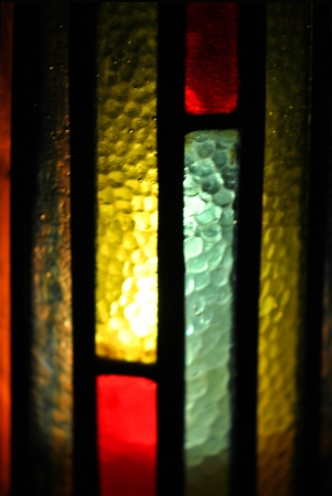 hurricane lamp: Closeup of stained glass lamp chimney