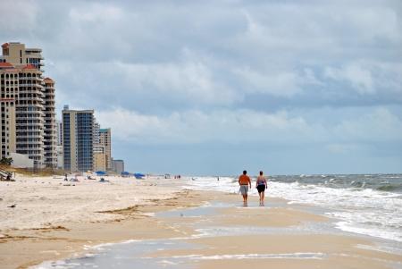 Tourists beachcombing on Perdido Key in northwestern Florida USA