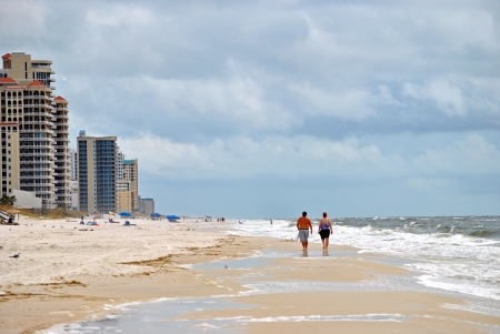 Tourists beachcombing on Perdido Key in northwestern Florida USA