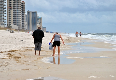 Tourists beachcombing on Perdido Key in northwestern Florida  Stock Photo - 15365793