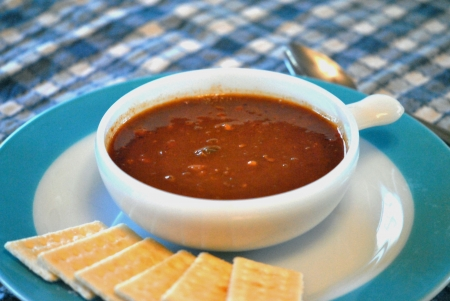 Chili con carne with beans, and crackers on the side  photo