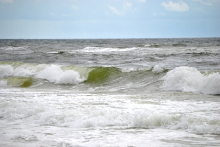 foaming: Frothy waves crashiing onto the shore