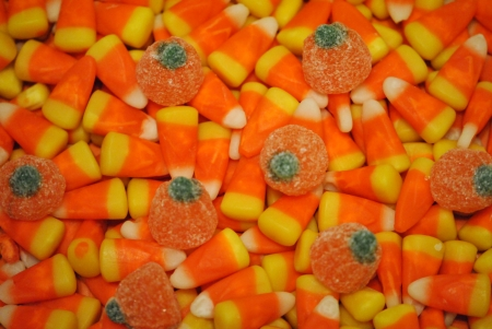 Candy corn and gumdrop pumpkin candy as background  photo