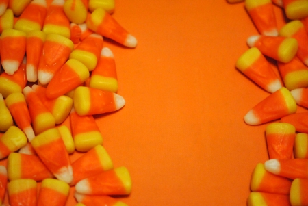 candy corn borders on an orange background Stock Photo - 16174086